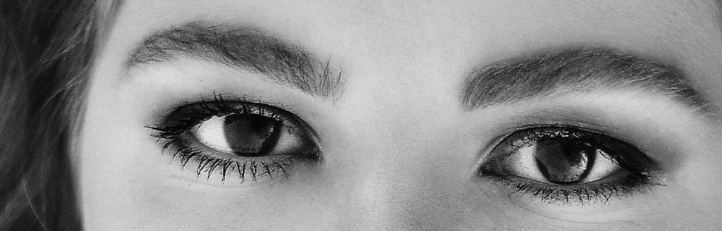 BW photo of perfectly made up and groomed eyes of a model